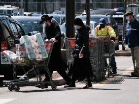 Shoppers wear masks in the Costco parking lot, due to the outbreak of the coronavirus disease (COVID-19) in the Brooklyn borough of New York